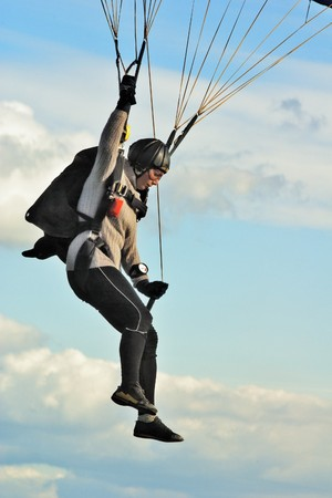 pilotage: The girl-parachutist prepares for a landing Stock Photo