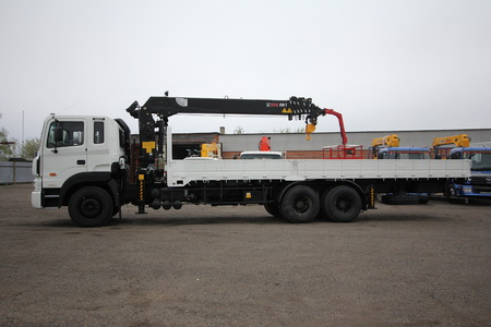 maneuverable: Great white auto truck crane standing on a construction site - Russia, Crimea - September, 21, 2016