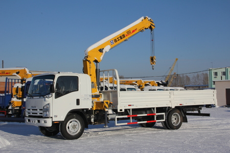 maneuverable: Great white auto truck crane standing on a construction site in winter - Russia, Crimea -January, 21, 2016