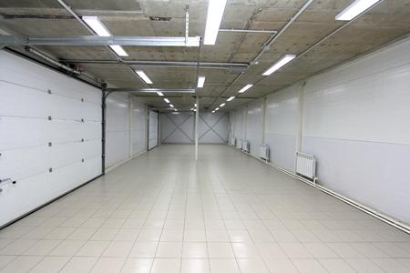 a Parking empty garage underground, warehouse interior with blank billboard