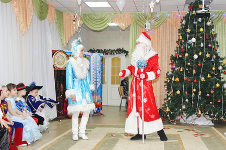 small children look like Santa Claus dancing on a holiday in kindergarten - Russia, Moscow on December 17, 2016 Editorial