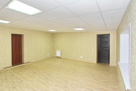 Interior empty office light room with green wallpaper without furniture in a new building