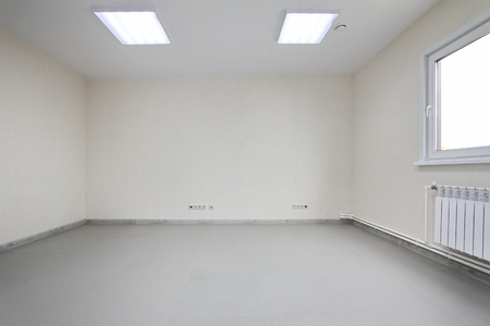 Interior empty office light room with white wallpaper without furniture in a new building
