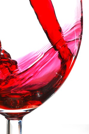 white wine: Red wine pouring into glass isolated on white background