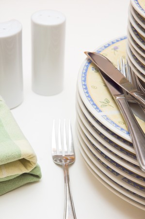 Getting ready for dinner;Plates, cutlery, �pepper and salt� and napkin Stock Photo - 4382431
