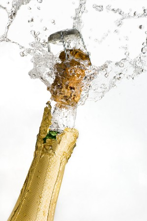 Close-up of explosion of champagne bottle cork photo