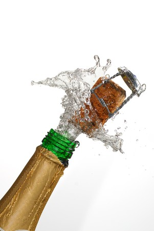 popping the cork: Close up of champagne cork popping with white background
