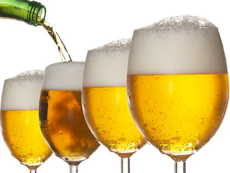 alcoholic: Pouring beer into four glasses with white background