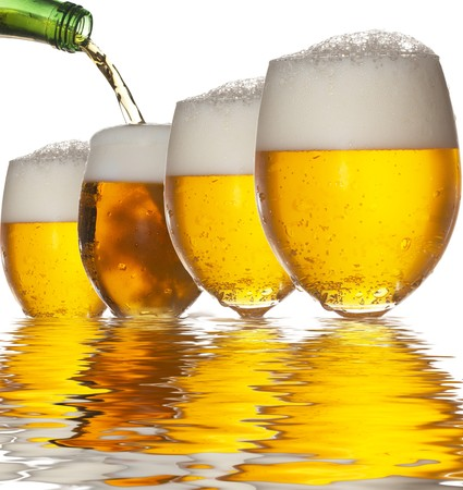Pouring beer into four glasses with white background and reflection