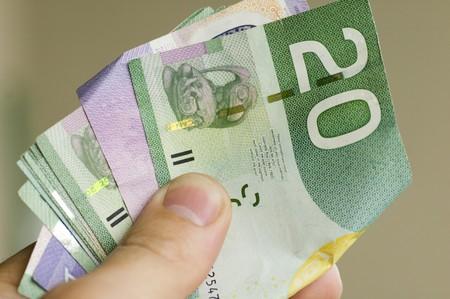 else: Man is giving offer, offering money to somebody else