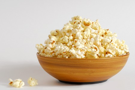 popcorn bowl: Bowl of popcorn with a white background
