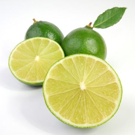 Freshly cut lime studio isolated on white background