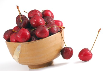 Bowl filed with cherries on white background Stock Photo - 4473200