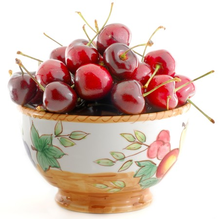 Cherry in bowl isolated on white background Stock Photo - 4473222