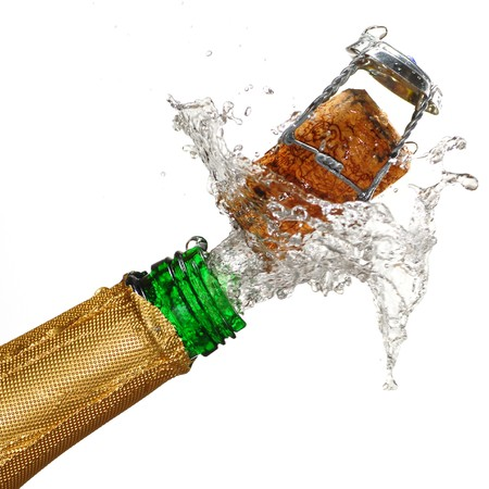 Close up of champagne cork popping with white background Stock Photo - 4482647