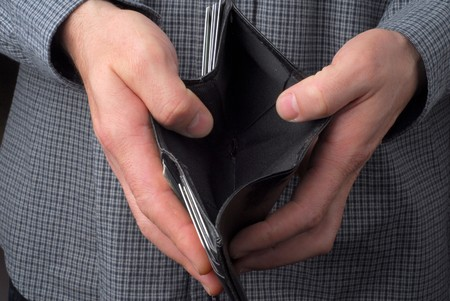 broke: Person hold an empty wallet Stock Photo