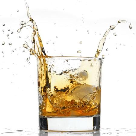 Whiskey splash studio isolated on white background photo