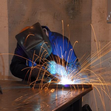 welding metal: Factory welder doing his hard job