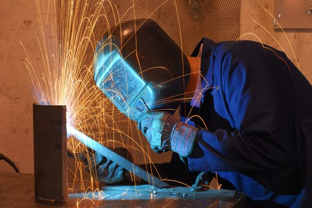 metallurgy: Factory welder doing his hard job