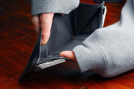 empty wallet: Person holding an empty wallet