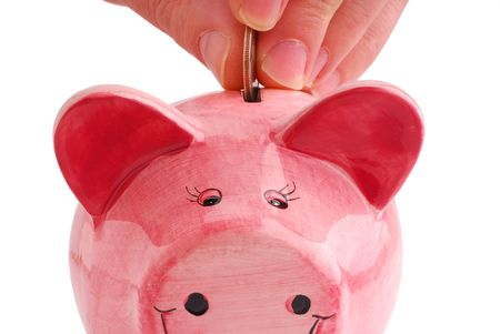 Filling up piggy bank studio isolated on white background photo