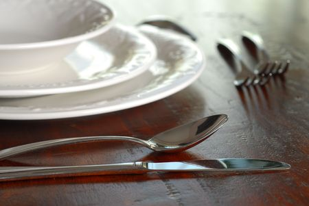Table set for dinner with plates and silverware Stock Photo - 4692752