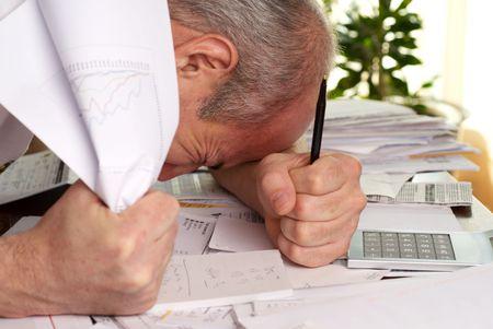 Hopeless man, man with no idea how to pay bills Stock Photo