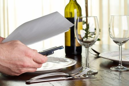 Business during dinner, calling business partner on telephone Stock Photo - 4720726