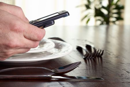 Business during dinner, calling business partner on telephone
