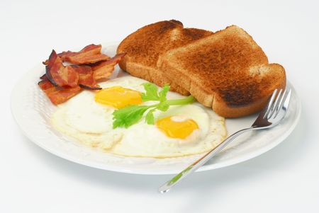 Extreme close-up image of fried eggs in a plate Stock Photo