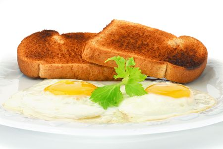 Extreme close-up image of fried eggs with toast photo