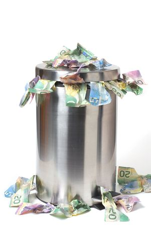 Garbage can overflowed with a lot of Canadian money