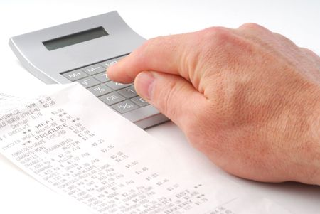 Person calculating bills using calculator studio isolated on white background Stock Photo