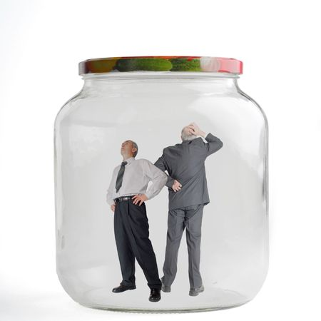 trapped: Two people trapped inside jar Stock Photo