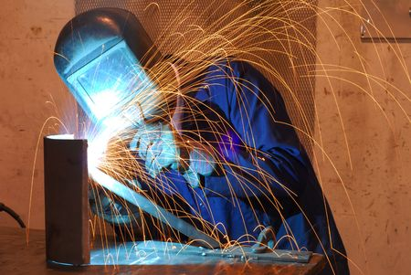 A worker is busy working on his new welding project