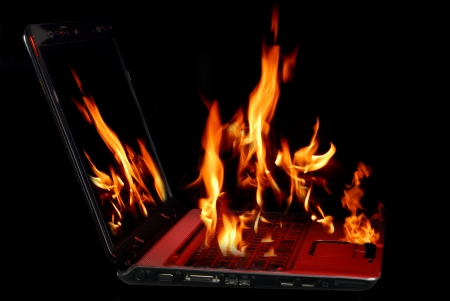 Image of laptop with fire burning from being over-used Stock Photo - 5483993