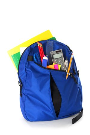 Backpack full of back to school supplies studio isolated on white background Stock Photo
