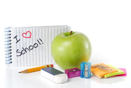 fournitures scolaires: School supplies with apple and message I Love School