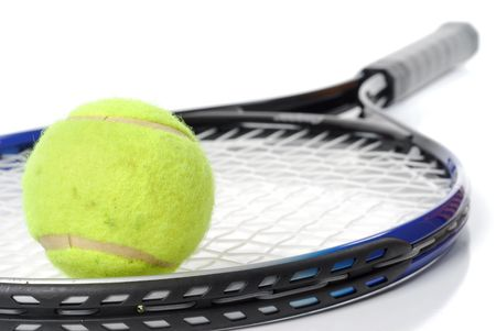 titanium: Tennis racket and ball studio isolated on white background