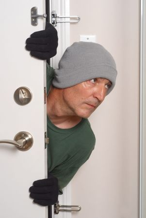 Burglar breaks into a residential building. Stock Photo - 5812910
