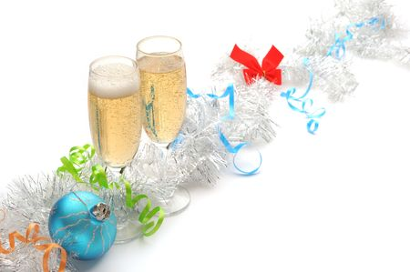 Champagne flutes and Christmas setting on white background photo
