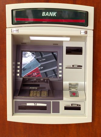 Close-up image of ATM cash machine with big screen photo