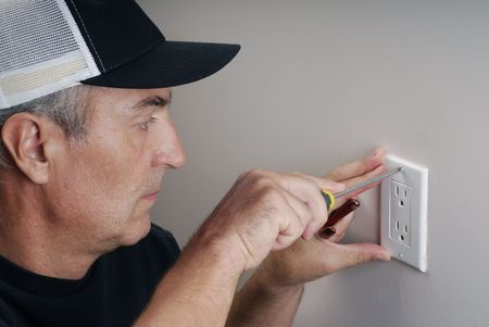 Close-up image of handy man fixing an electricity outlet Stock Photo - 6046915