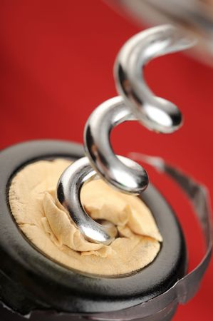 cork screw: Extreme close-up of wine bottle and cork screw