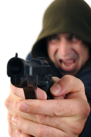 A man wearing a hood aiming a gun with white background photo
