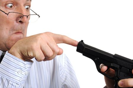 A man playing with a gun on white background photo