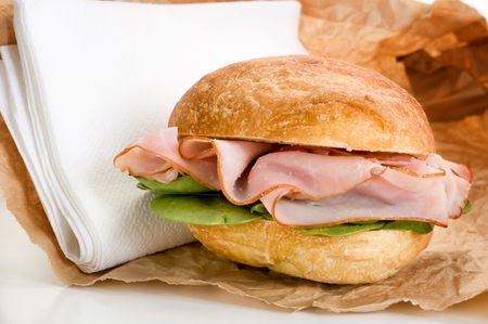 Close-up image of fresh made sandwich with spinach and salami photo