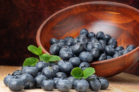 Close-up image of blueberries with mint