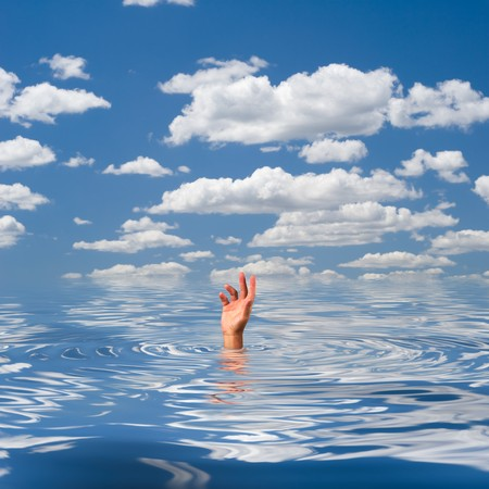 The hand of a drowning man sticking out of water Stock Photo - 7313427