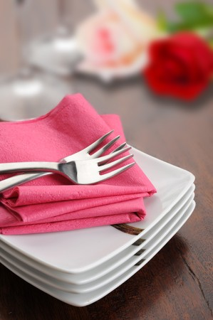 Table set for dinner with glass and flowers Stock Photo - 7417467